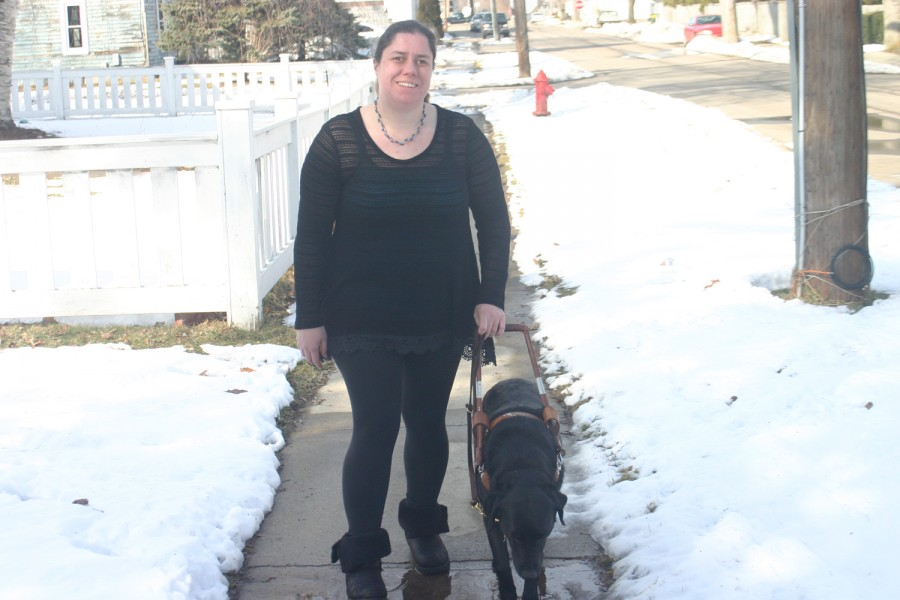 Jill Ogden and her dog Quest go for a stroll outside of their around their Stockbridge home on February 28.