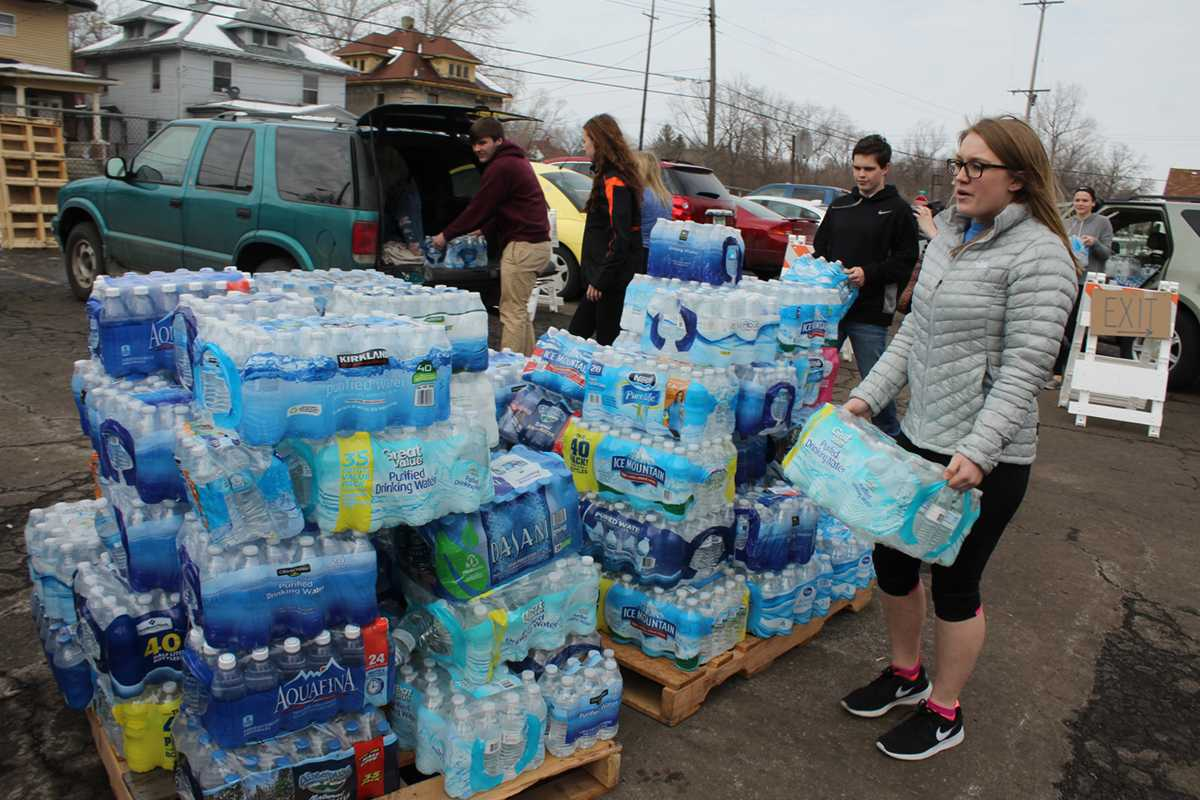Unloading donated water, senior Amanda Page, member of the National Honor Society, helps take water to Flint to assist the community members with the water crisis.