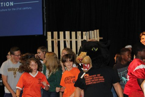 Getting down on the dance floor, sophomore Gabriel Millen, the panther mascot, represents Stockbridge High School at the Mike Smith Conference by showing off his moves in the dance competition held at the beginning of the event.