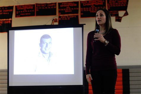 Probation officer, Jesse Besonen, talks to a crowd of students at Stockbridge high school's anti-drug rally