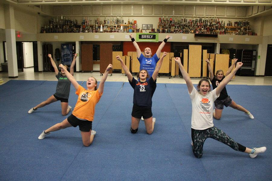 After rolling out the mats, and completing their stretches and warm ups, the competitive cheer team works on perfecting their routines for their upcoming competition.