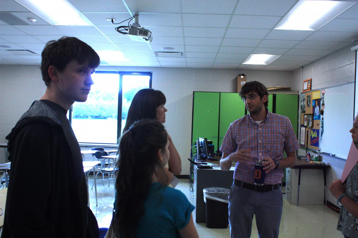Math instructor, Mr. Rickli talking to students at open house.