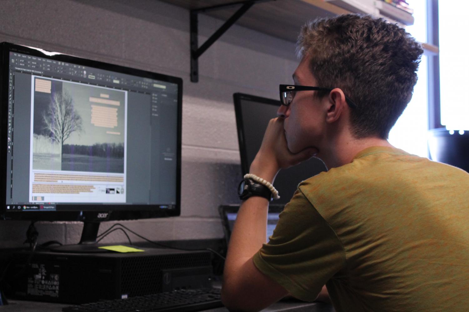 Reporter Logan Connolly works on how to amp up a layout created on Indesign.
