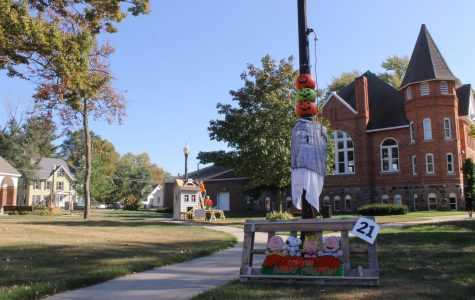 On the west side of the town hall, families and business decorate light poles with a theme. Charlie Brown the Great Pumpkin and spooky skeleton construction workers surround some of the light pole in town.