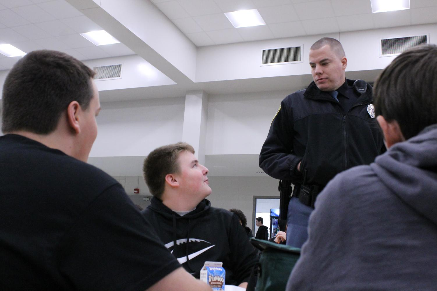 Engaging with students at lunch, Resource Officer Brad Hagman engages with Students at Lunch. Hagman hopes to take on a mentor role to the students and be someone they can talk to.