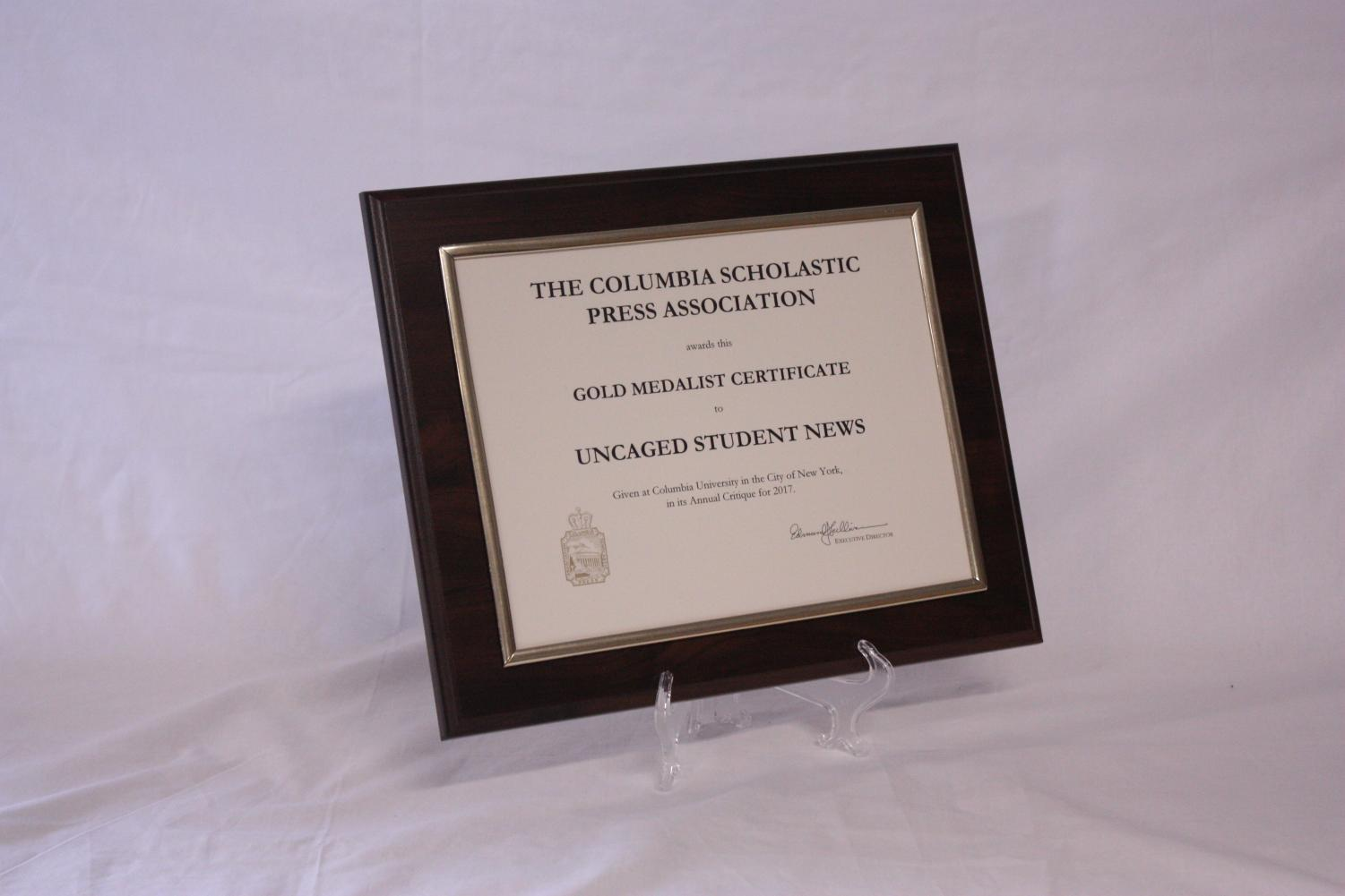 The+Columbia+Scholastic+Press+Association+gives+the+Gold+Medalist+Certificate+to+Uncaged+Student+News