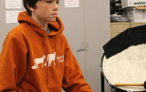 "Beating his drum, William Marshall, grade seven, practices for a band concert.  ""He's a creative and intelligent kid"" Substitute teacher Diane Wilson said."