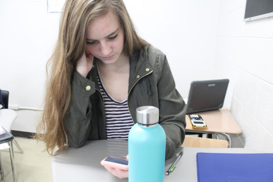 After finishing her work in Algebra C, Rose Casto checks  her grades. In a life time, the average human will spend five years and four months on social media today.