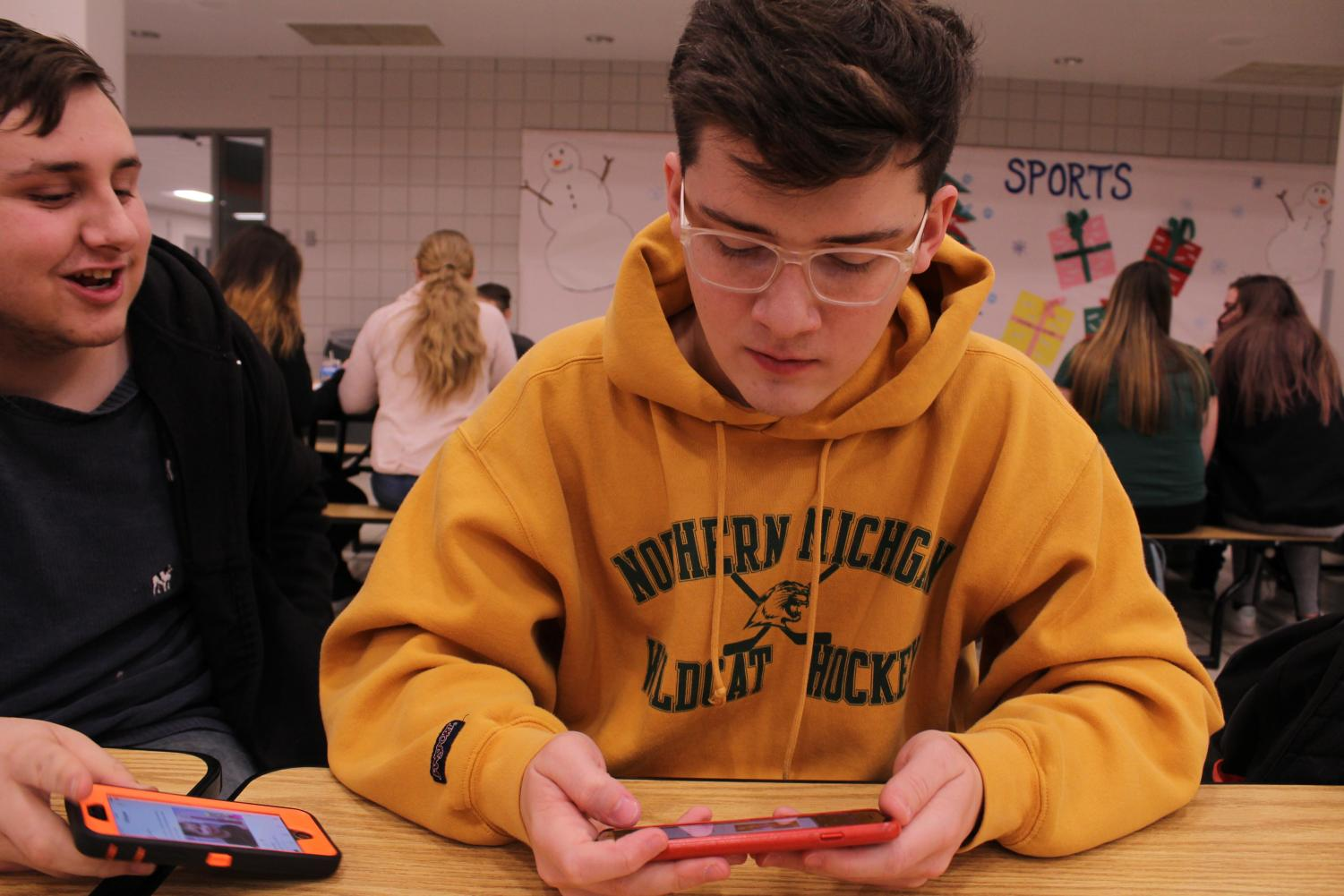 Students like junior Andrew Carriero play Fortnite in school, distracting both themselves and the other students around them.