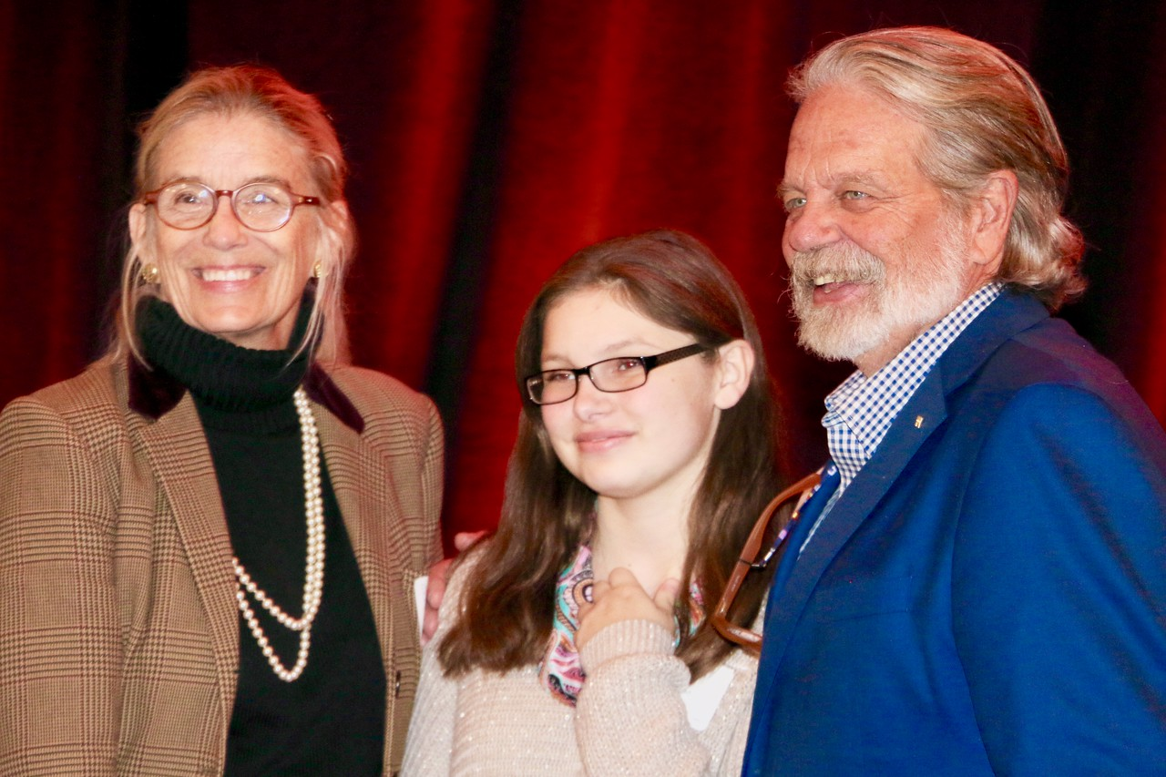 Wood and Betsy Stover congratulate eighth grader Ivori Hufnagel (middle) after her speech at Ele's place. Her bravery was awarded with great gratitude.