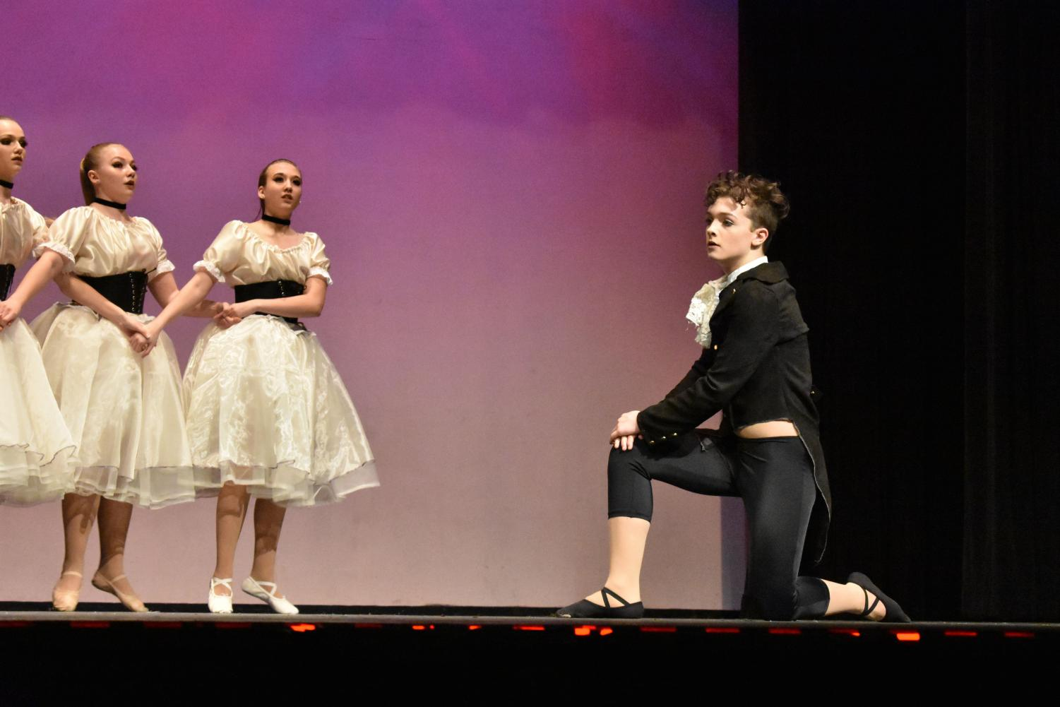 Sophomores Haylie Steinkraus, Makenna Allison and freshman Joshua Pena preform at a dance recital in Chelsea, describing a painting by Edgar Degas, a French painter from the mid-1800s who frequently painted ballet dancers.