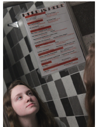 Every trip to the girls' restroom for sophomore Isabelle Scutchfield and others includes a glance at the chart of contacts to call for help including human smuggling.