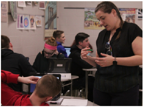Explaining a U.S. history assignment about the western frontier exhibited through political cartoons, teacher Kathleen Riley uses guided teaching as her methodology to assist students.