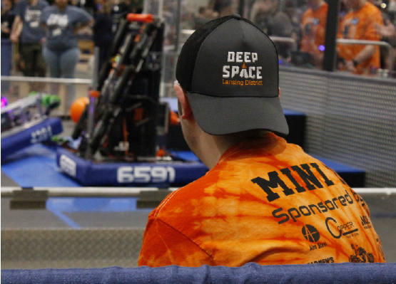 Senior Hunter Fee from team 6591 Panther Powered watches the robot at state competition in Saginaw University. As captain,