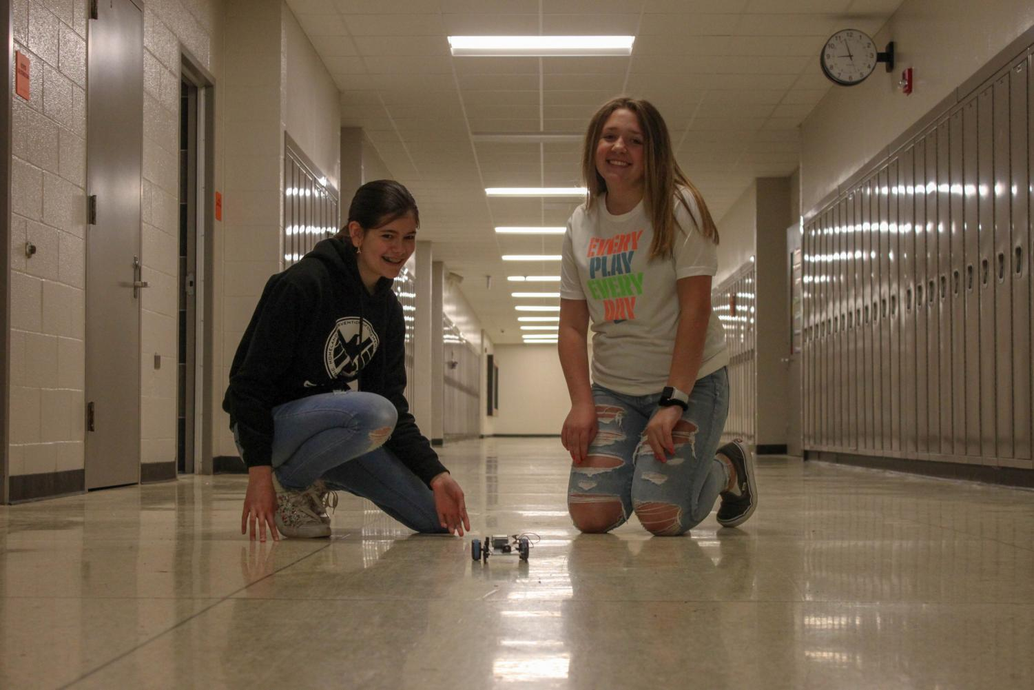Happiness. While working on a robotics project, eighth graders Emily VanPelt and Kenzie Dalton express happiness when told they will get out of school a day early.