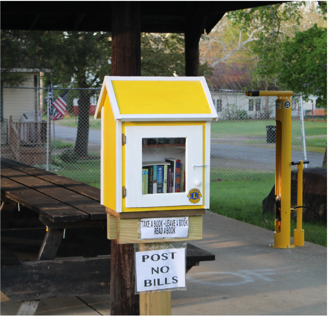 Located+in+Munith+Park%2C+a+little+yellow+library+sits+under+the+pavillion.+Take+a+seat+at+the+table+and+enjoy+a+book.+English+teacher+Jessica+Martell+plans+to+make+use+of+the+little+library.+%22I+was+really+excited+to+see+it+there%2C+and+I+plan+on+making+use+of+it+over+the+summer%2C%22+Martell+said.