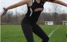 Practicing discus, Sophomore Carissa Heinzman tries to perfect her double spin, after over coming the obstacles after extensive foot surgery. She excels and has broken personal records thus far this season.