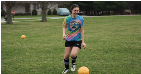 Sophomore Malena Rosedale practices shooting goals and dribbling in the practice soccer field for her upcoming soccer game. Communicating with other teammates with a smile and building up to kick for a clean pass.