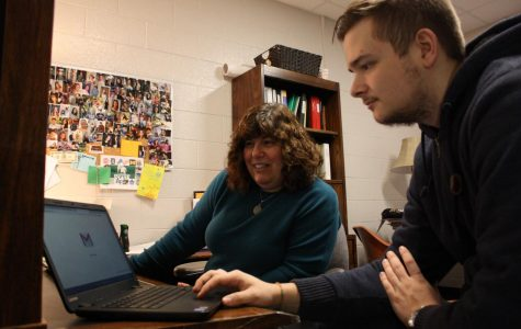Counselor Leslie Cummings helps Frederick Choate 12 figure out how to send his transcript to Kettering University.