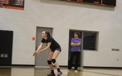 Coach returns from time off the volleyball court
