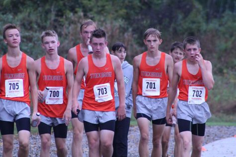 Cooling down after the quick race, Dalton Satkowiak 10, Micah Bolton 9, Brock Jones 11, Collin Cook 9, Andy Schlaff 11, Cameron Brewer 11, Ryan Owen 9 and Ben Chapman 10 of boys cross team take another lap around the home course. The team finished 4th in the meet.