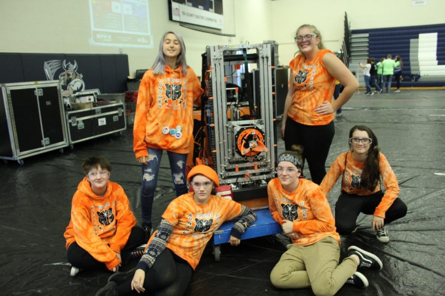 The girls pause to enjoy their first all-girl experience at Grand Rapids robotics competition. Viviannah Moffett 9, Brianna Polenz 9, Abigail Schlaff, 9, Melanie Eskew 11, Grace Dreier 10 and Shaddai Demerath-Shanti 12 placed second in the finals.