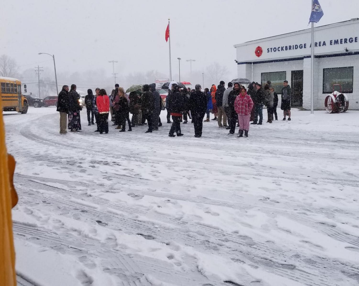 During a rare November snow storm, all of the staff and students evacuate to the S.A.E.S.A site as the bomb task force team checks the junior/senior high building. Students are held on buses until family members sign them out or until the bus takes them home.