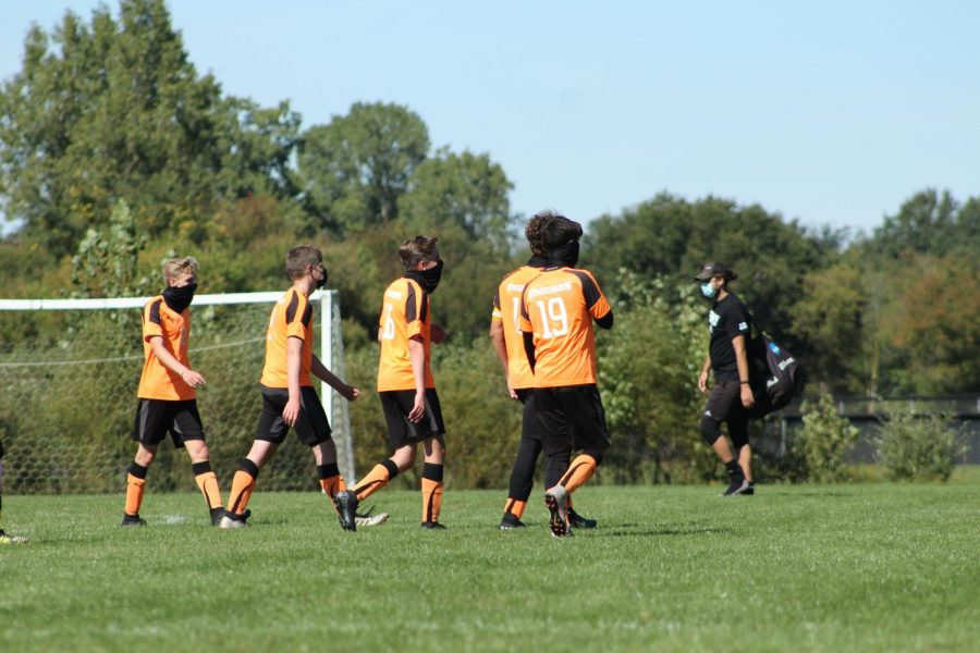 In Michigan, MHSAA's new pandemic regulations on sports have affected many athletes. As of June 2, athletes are forced to wear masks during their games, and many other sport specific rules were put in place. (Pictured from left to right, Jonah Huskey-Wright, Jacob Olson, Jordan Huskey-Wright, Isaac Lance and Carson Oversmith).