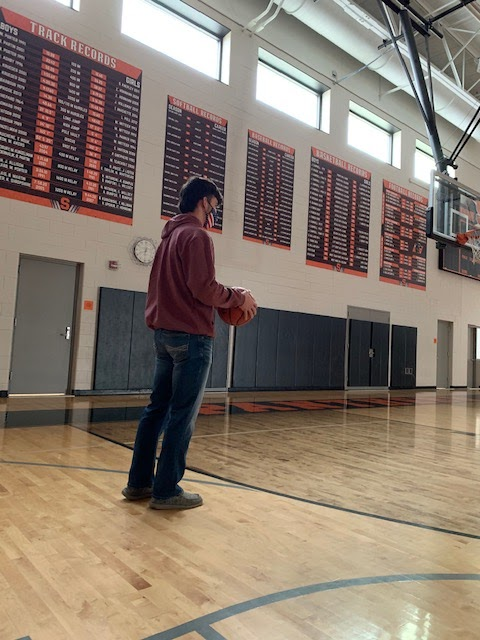 Noah Robidou, 12, practices shooting at Stockbridge High School. The clock is running out not on the scoreboard, but time for the season. The basketball season starts on February 21st 2021.