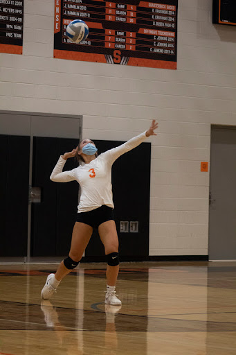 Sophomore outside hitter Gracee Robidou serves the ball in the Stockbridge Panthers first win against Quincy. They ended the night with a close win going into all five sets.