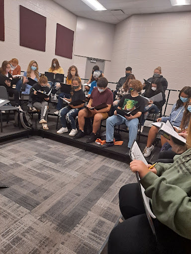 With sheet music in hand, and melodies on their mind, the choir begins its rehearsal for the day. They prepare to sing difficult material, the group adjusts to the new choir program.