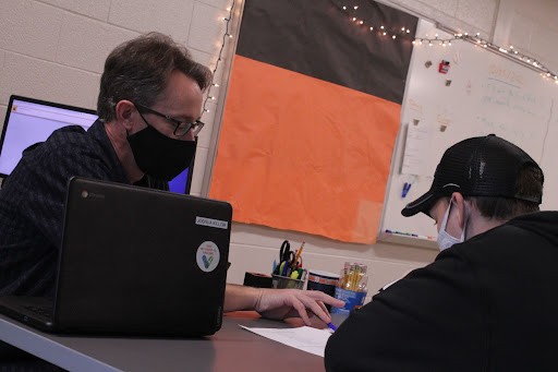 While working with academic support student Trevor Poole, teacher Joshua Killom explains a tough government assignment. Killom's classroom is a friendly environment that helps students learn and work through their struggles.